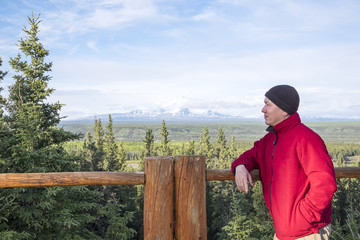 Man with Fleece Hat and Jacket Admiring a Mountain View