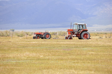 Tractor on farm in rural landscape