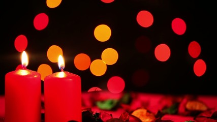 Red Candles and Bokeh Colorful Lights