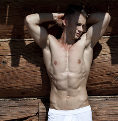 Portrait of a very muscular shirtless male model