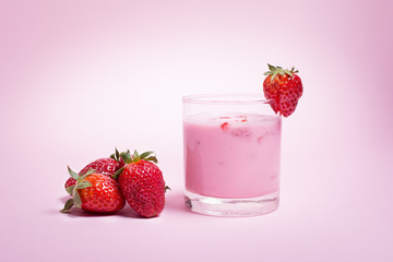 Strawberry smoothie on pink background