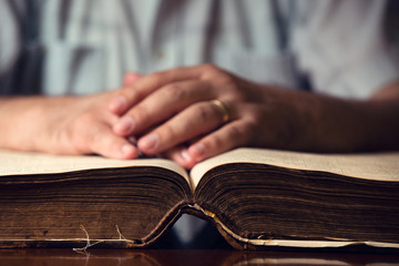 Male Hand On Open Bible