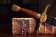 Leinwanddruck Bild - Old Bible With Sword