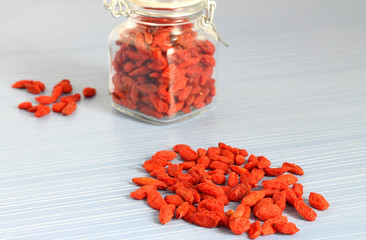 Dried Goji berries and glass jar