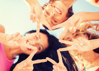 girls looking down and showing finger five gesture