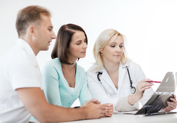 doctor with patients looking at x-ray
