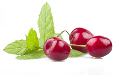 Fresh Cherry and leaves of mint on the white