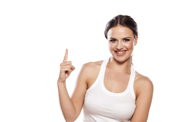 happy young woman showing with her finger up