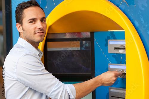 canvas print picture Mann am Geldautomat