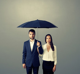 couple under umbrella over dark