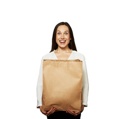 excited woman holding paper bag