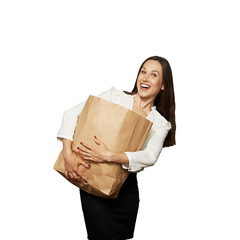 laughing woman holding heavy paper bag
