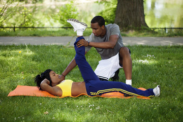 Black Couple Working Out In Park On Grass