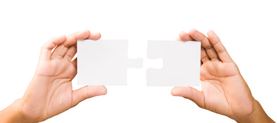 connection concept. hands with pieces of puzzle on white backgro