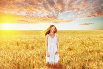 Beautiful young woman in wheat field