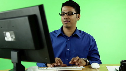 confident business man with computer on green screen