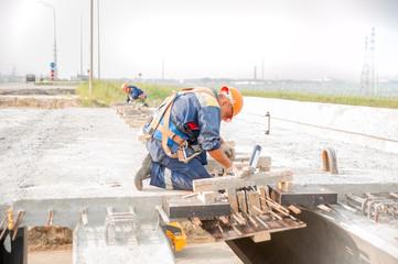 Workers on bridge construction