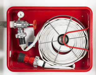 Fire hose equipment in a red metallic box