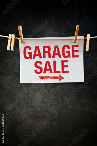 Garage Sale sign hanging on clothes rope