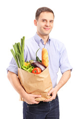 Man holding a bag full of groceries