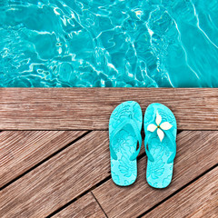 Blue flip flops on a wooden deck