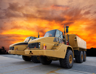 Heavy mining truck at sunset
