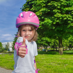 Preschool girl in protective sportwear