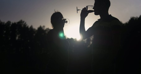 Young couple drinking wine and kissing. Ultra HD 4K video