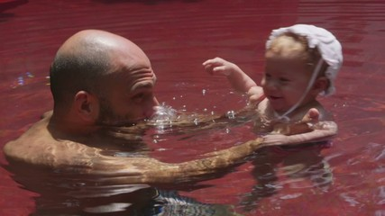 1of8 Happy people, dad, father, child, baby, swimming pool