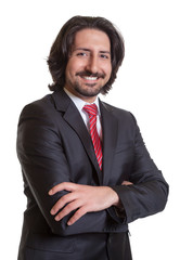 Standing turkish businessman with crossed arms