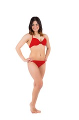 Fit girl in red bikini smiling