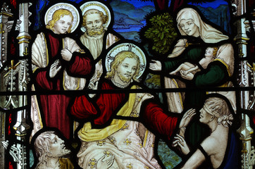 Christ healing sick and blind people. Stained glass.