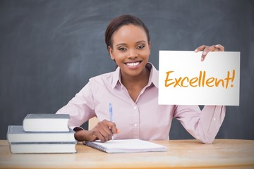 Happy teacher holding page showing excellent