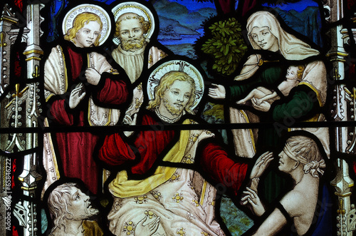 Christ healing sick and blind people. Stained glass. - 65846222