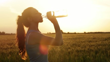 Tired Female Jogger Drinking Water Beautiful Summer Sunset