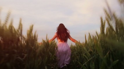 Beautiful Girl Running Through Field at Sunset Slow Motion