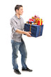 Young man holding a bunch of presents