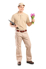 Delivery guy holding a bunch of flowers