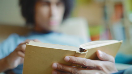 young, attractive man is reading a book