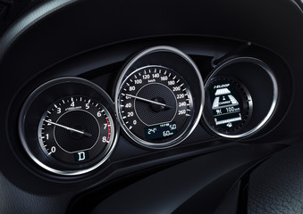 Modern car illuminated dashboard closeup