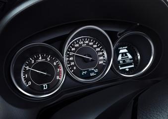 Modern car illuminated dashboard closeup