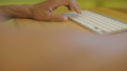 Closeup of man's hands who uses a keyboard