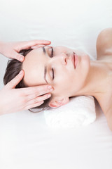 Woman during face massage