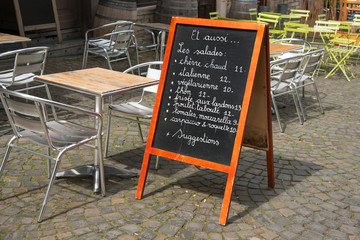 Menu by the sidewalk cafe on Brussels street