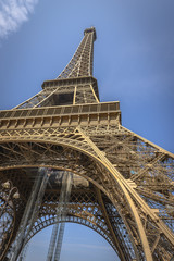 Eiffel Tower shot from a low angle from one of the pillars
