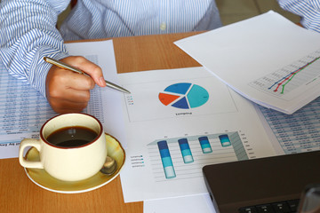 forcast, analysis sales charts, graphs report with coffee cup
