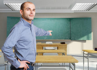 Male teacher pointing to the blackboard
