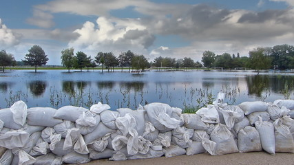 Defence of the flooded river, levee of sandbags
