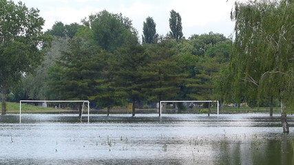 Flooded football field in town