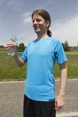 Jogger man with a water bottle
